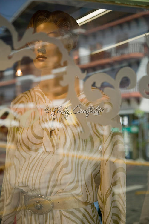 Shop window with dress and reflection of typical architecture of Vila Capivari, Campos do Jordao, SP, Brazil.