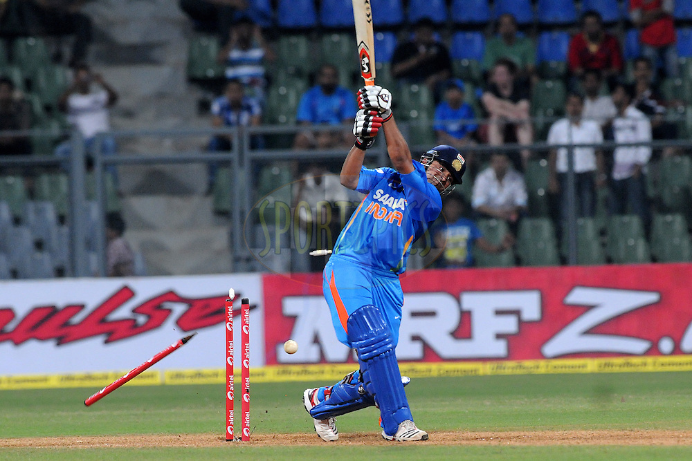 Suresh Raina of India gets bowled out during the 4th One Day International ( ODI ) match between India and England held at the Wankhede Stadium, Mumbai on the 23rd October 2011..Photo by Pal Pillai/BCCI/SPORTZPICS.