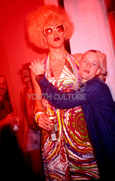A clubber hugs a drag queen in the Gay Traitor bar of the Hacienda at the Flesh night, Hacienda, Manchester 1989