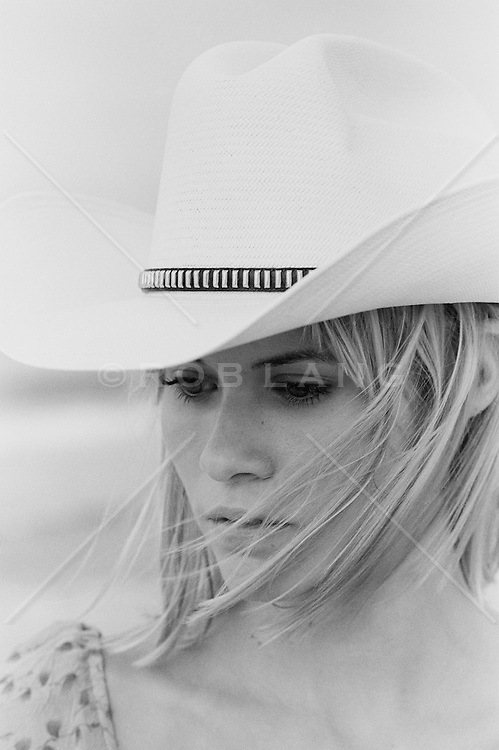 Cowgirl outdoors in the wind