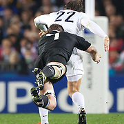 Richie McCaw, New Zealand, playing his 100th test match, dives to make a tackle of Cedric Heymans, France, during the New Zealand V France, Pool A match during the IRB Rugby World Cup tournament. Eden Park, Auckland, New Zealand, 24th September 2011. Photo Tim Clayton...