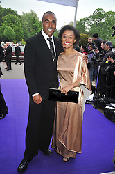 Athlete COLIN JACKSON and his sister actress SUZANNE PACKER at The Butterfly Ball in aid of the Caudwell Children Charity held in Battersea park, London on 14th May 2009.