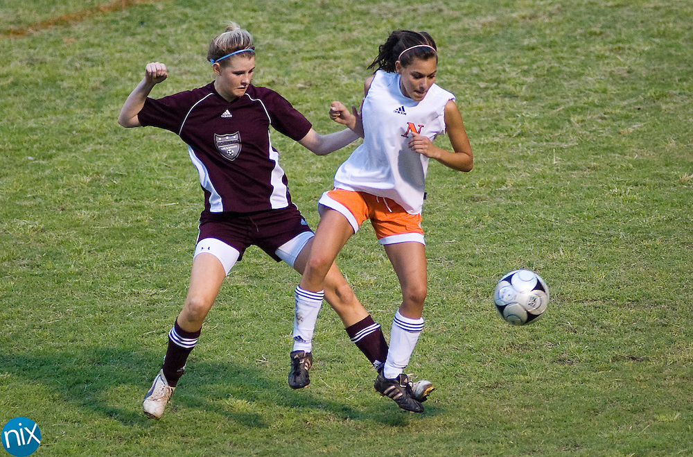 Northwest Cabarrus' Stephani Isidori fights for the ball against Jay M. Robinson's Meredith Mayhew Friday night at Northwest Cabarrus High School. The game went into overtime and ended in a 3-3 tie. (Photo by James Nix)