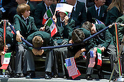 Local school children hold Mexican and American flags as they wait for US President Barack Obama and Mexican President Felipe Calderon to arrive at a welcoming ceremony at Los Pinos in Mexico City on 16 April 2009. Obama and Calderon will attend the Summit of the Americas in Trinidad and Tobago this weekend.