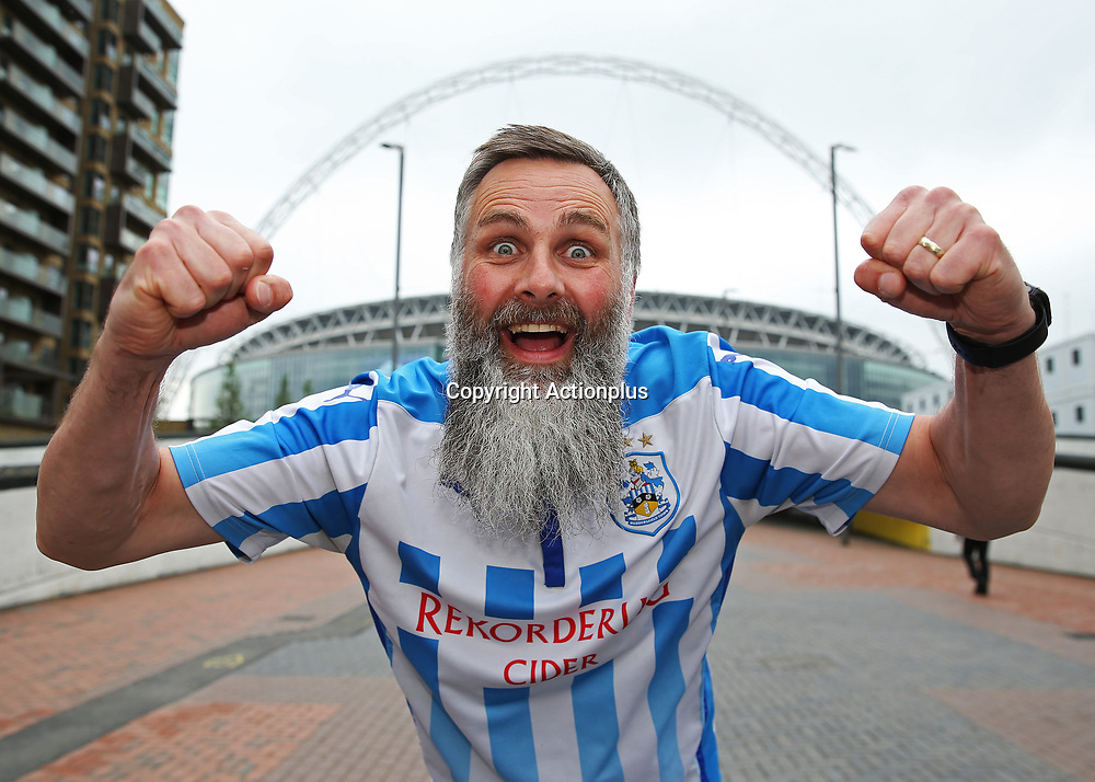 May 29th 2017, Wembley Stadium, London, England; EFL Championship playoff final, Huddersfield Town versus Reading; Huddersfield Town fan gesturing outside Wembley Stadium before kick off