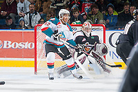 KELOWNA, CANADA - JANUARY 7: Tyrell Goulbourne #12 of Kelowna Rockets looks for the pass in front of the net of Cody Porter #35 of Vancouver Giants on January 7, 2015 at Prospera Place in Kelowna, British Columbia, Canada.  (Photo by Marissa Baecker/Shoot the Breeze)  *** Local Caption *** Tyrell Goulbourne; Cody Porter;