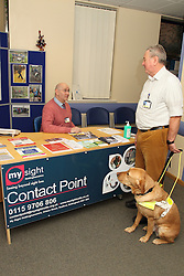 Patient with guide dog at Mysight contact point, for people with visual impairment, based at QMC hospital, Nottingham.