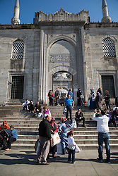 Locals and tourists visit Yeni Cami, or New Mosque, in the Eminonu area of Istanbul, Turkey.