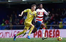 January 28, 2017 - Vila-Real, Castellon, Spain - Samu Castillejo of Villarreal CF and Martin Hongla of Granada CF during their La Liga match between Villarreal CF and Granada CF at the Estadio de la Ceramica on 28 January 2017 in Vila-real, Spain. (Credit Image: © Maria Jose Segovia/NurPhoto via ZUMA Press)