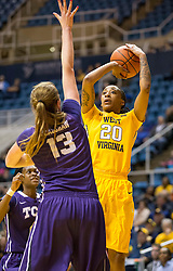West Virginia Mountaineers guard Breana McDonald (20) shoots over TCU Horned Frogs center Klara Bradshaw (13) at the WVU Coliseum.