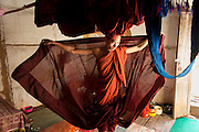 Monk dressing before leaving to collect alms in the morning. Kalaw. Nan Palan Temple.