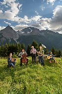 The famous musician Domenic Janett and others from the area in the shadow of the Piz Ela, Bergün, Parc Ela, Grisons, Switzerland
