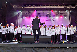 © Licensed to London News Pictures. 02/07/2017. London, UK. Members of The Voice of Peace Children's Choir on perform on stage.  People celebrate the EID Festival in Trafalgar Square, an event hosted by The Mayor of London.  The Mayor's festival takes place in the square one week after the end of Ramadan and includes a variety of stage performances and cultural activities. Photo credit : Stephen Chung/LNP