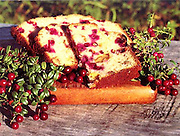 Alaska. Cooking fresh cranberry bread, garnished with wild cranberries.
