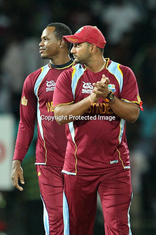 Ravi Rampaul of The West Indies applauds as the decision is out for David Warner during the ICC World Twenty20 semi final match between Australia and The West Indies held at the Premadasa Stadium in Colombo, Sri Lanka on the 5th October 2012<br /> <br /> Photo by Ron Gaunt/SPORTZPICS