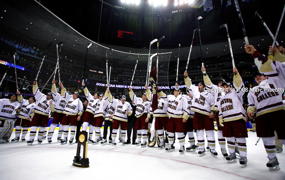 SHOT 4/12/08 8:03:53 PM - Boston College hockey team members salute their fans with the national championship trophy in front of them after beating Notre Dame 4-1in the NCAA Frozen Four championship game at the Pepsi Center in Denver, Co. It is Boston College's third national championship in men's hockey..(Photo by Marc Piscotty / © 2008)