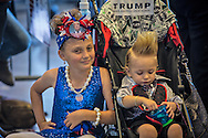 Cassie Jeffery, 8 with her brother  19 month old Curtis Ray Jeffrey II,from f Bluff Creek, LA ,at a campaign rally in New Orleans for Republican presidential candidate Donald Trump. The New Orleans rally on Friday, March 4, 2016 at Lakefront Airport took place a day before the primary vote.<br /> The New Orleans rally on Friday, March 4, 2016 at Lakefront Airport took place a day before the primary vote.