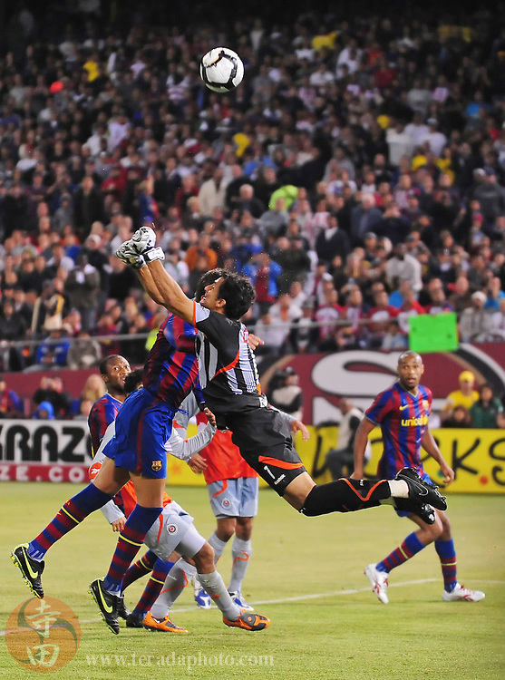 August 8, 2009; San Francisco, CA, USA; FC Barcelona defender Gerard Pique (left) heads the ball with Chivas de Guadalajara goalkeeper Luis Michel (1) during the first half in the Night of Champions international friendly contest at Candlestick Park. The game ended in a 1-1 tie.