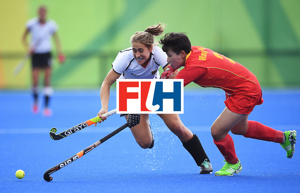 China's Wang Mengyu (R) and Germany's Marie Mavers fight for the ball during the women's field hockey China vs Germany match of the Rio 2016 Olympics Games at the Olympic Hockey Centre in Rio de Janeiro on August, 7 2016. / AFP / MANAN VATSYAYANA        (Photo credit should read MANAN VATSYAYANA/AFP/Getty Images)