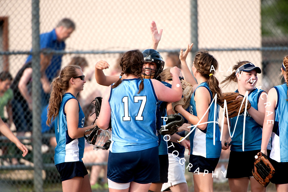 St. Thomas girls celebrate their victory over Laconia at Memorial Park on Wednesday, June 2, 2010.  (Alan MacRae/for the Citizen)