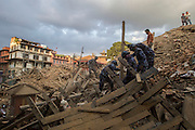KATHMANDU, NEPAL - APRIL 26: (CHINA OUT)<br /> <br /> Police soldiers search on the ruins where used to be Durbar Square on April 26, 2105 in Kathmandu, Nepal. A 8.1-magnitude earthquake struck Nepal on Saturday and the earthquake felt in southeast China\'s Tibet Autonomous Region which brought some houses into collapse. While another 7.1-magnitude earthquake hit the county again the following day afternoon. Chinese government sent out Sichuan Rescue Team, the only one national emergency medical rescue team who could settle camps above an altitude of 3500 meters, to Nepal to support local rescue work and international assistance were also sent to the disaster areas. The earthquake had caused at least 3218 people to death and parts of Chinese visitors were detained in Nepal by Monday morning. <br /> ©Exclusivepix Media