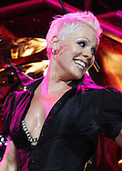 "NICE, FRANCE - JULY 13:  Pink performs on the ""FUNHOUSE SUMMER CARNIVAL TOUR 2010"" on July 13, 2010 in Nice, France.  (Photo by Tony Barson/WireImage)"