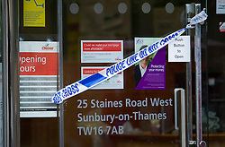 "© London News Pictures. 07/05/2013. Sunbury-on-Thames, UK. Police tape outside Chelsea Building Society in Sunbury-on-Thames, in Surrey, which was robbed earlier today (Wed). 55-year-old escaped prisoner Michael Wheatley AKA ""Skull Cracker"", who was arrested in east London, is alleged to have carried out the robbery. Photo credit: Ben Cawthra/LNP"
