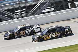 July 1, 2018 - Joliet, Illinois, United States of America - Clint Bowyer (14) and Aric Almirola (10) battle for position during the Overton's 400 at Chicagoland Speedway in Joliet, Illinois  (Credit Image: © Justin R. Noe Asp Inc/ASP via ZUMA Wire)