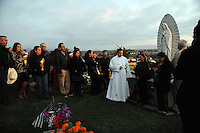 As twilight falls, remembrances are made. In a touching final celebration of All Soul's Day on Saturday night, hundreds of congregants came to Queen of Heaven Cemetery in Salinas to attend mass, offer their prayers, and as dusk fell, participate in a candlelight procession.  Friends and family members sat by the graves of loved ones, many of which were decorated with traditional Day of the Dead marigolds, photographs of the departed, and things that were their favorites in life.