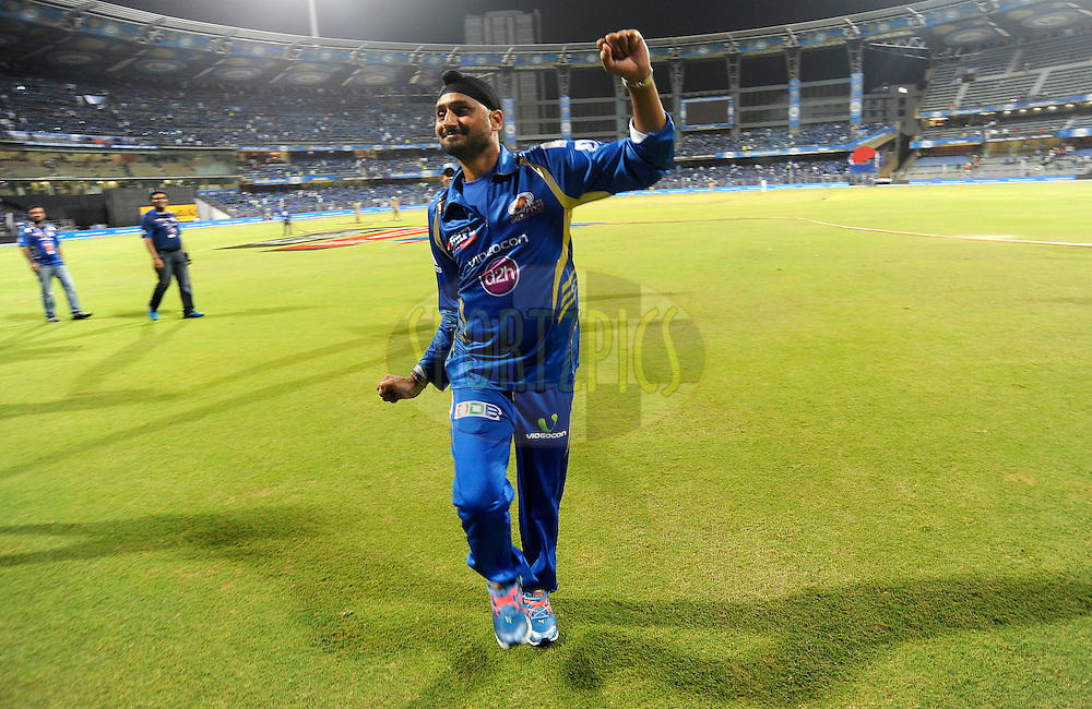 Harbhajan Singh of the Mumbai Indians dances for the Under Privilege children as he take a lap of the ground with the team after match 22 of the Pepsi Indian Premier League Season 2014 between the Mumbai Indians and the Kings XI Punjab held at the Wankhede Cricket Stadium, Mumbai, India on the 3rd May  2014<br /> <br /> Photo by Pal Pillai / IPL / SPORTZPICS<br /> <br /> <br /> <br /> Image use subject to terms and conditions which can be found here:  http://sportzpics.photoshelter.com/gallery/Pepsi-IPL-Image-terms-and-conditions/G00004VW1IVJ.gB0/C0000TScjhBM6ikg