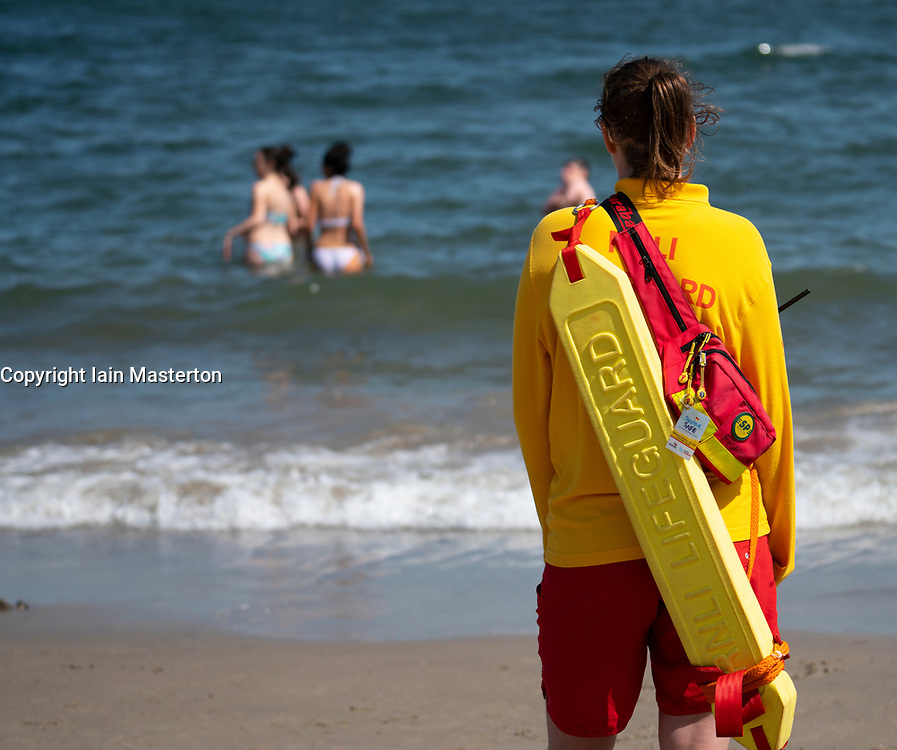 Aberdour, Fife, Scotland, UK. 28 June, 2019. Lifeguards were kept busy at Silver Sands Beach at Aberdour as warm weather and sunshine attracted dozens of people to the seaside.