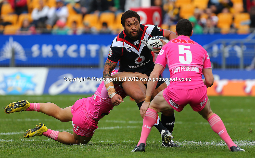 Manu Vatuvei of the Warriors is tackled during the NRL game, Vodafone Warriors v Penrith Panthers, Mt Smart Stadium, Auckland, Sunday 19 August  2012. Photo: Simon Watts /photosport.co.nz