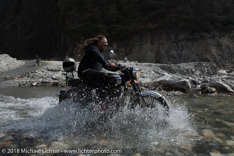 Beanre (Kevin Doebler) racing through a water crossing on Day-7 of our Himalayan Heroes adventure riding from Tatopani to Pokhara, Nepal. Monday, November 12, 2018. Photography ©2018 Michael Lichter.