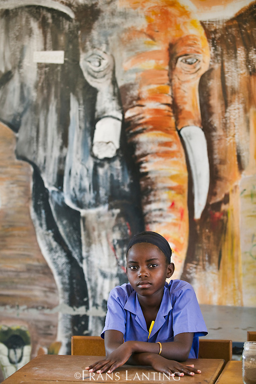 Student and mural inside school, Puros Village, Puros Conservancy, Damaraland, Namibia