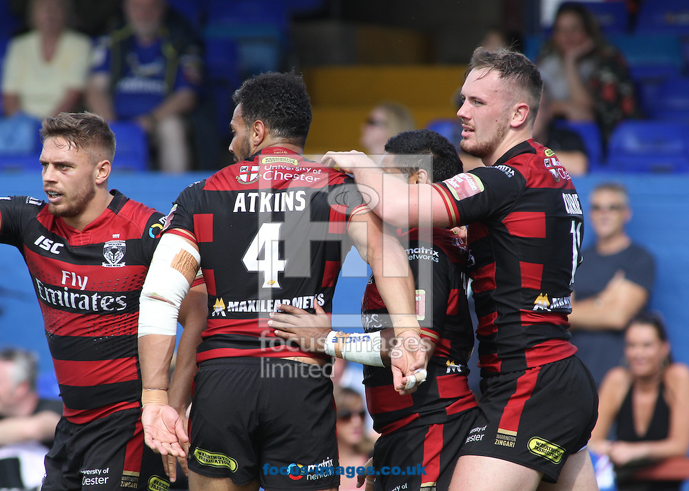 Ben Currie (R) of Warrington Wolves  celebrates scoring his try with team mate Ryan Atkins (L)  against Wakefield Trinity Wildcats during the Super 8s match at Belle Vue, Wakefield<br /> Picture by Stephen Gaunt/Focus Images Ltd +447904 833202<br /> 14/08/2016