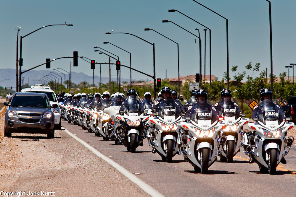 04 AUGUST 2010 -- GILBERT, AZ: Motorcycle officers lead the procession down Elliot at the funeral for Chandler police detective Carlos Ledesma Wednesday. Ledesma was killed during a shoot out with suspected drug dealers during an undercover operation in south Phoenix Wednesday July 28.   PHOTO BY JACK KURTZ