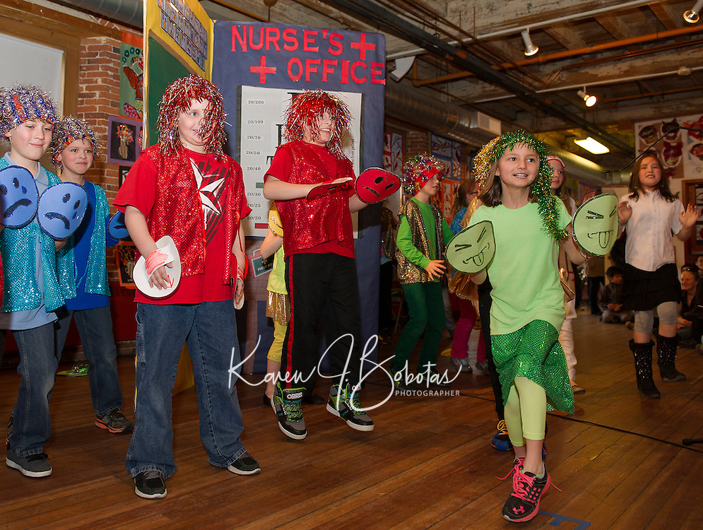 """Gilford Elementary student Alysen Pichette as """"jealousy"""" dances along with """"sadness"""" (blue), """"angry"""" (red), """"happy"""" (yellow) and """"rainbow"""" (silly) during Mrs. Young's 3rd graders skit """"Feel the Moment with Poetry"""" during opening night for Arts Alive at the Belknap Mill Thursday evening.    (Karen Bobotas/for the Laconia Daily Sun)"""