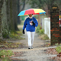 Adam Robison | BUY AT PHOTOS.DJOURNAL.COM<br /> Betty Lee Marshall, of Tupelo, takes a walk in the rain Monday morning on North Green Street in Tupelo.