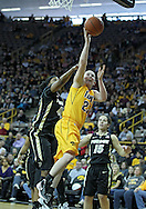 January 28, 2012: Iowa Hawkeyes guard Samantha Logic (22) puts up a shot as Purdue Boilermakers forward Alex Guyton (41) defends during the NCAA women's basketball game between the Purdue Boilermakers and the Iowa Hawkeyes at Carver-Hawkeye Arena in Iowa City, Iowa on Saturday, January 28, 2012.