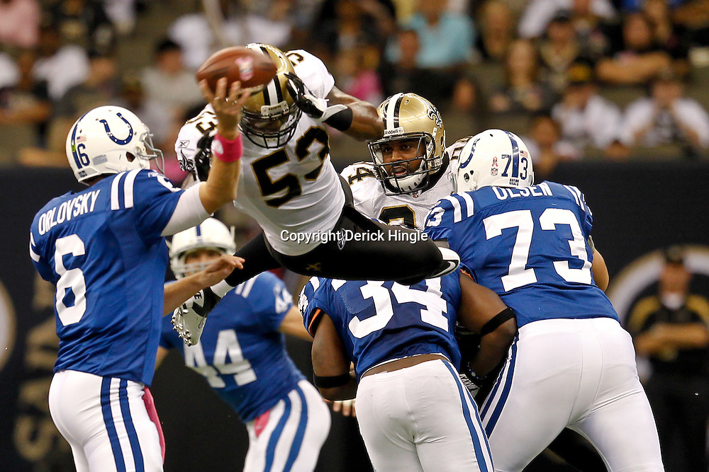 October 23, 2011; New Orleans, LA, USA; New Orleans Saints linebacker Ramon Humber (53) leaps to pressure Indianapolis Colts quarterback Dan Orlovsky (6) during the fourth quarter of a game at the Mercedes-Benz Superdome. The Saints defeated the Colts 62-7. Mandatory Credit: Derick E. Hingle-US PRESSWIRE / © Derick E. Hingle 2011