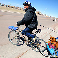 022813  Adron Gardner/Independent<br /> <br /> Flynn Donoho and his dog Diva roll onto North 9th Street in Gallup Thursday.
