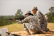 A woman Drill Sergeant candidate prepares to fire her rifle at the US Army Drill Instructors School Fort Jackson during weapons training September 26, 2013 in Columbia, SC. While 14 percent of the Army is women soldiers there is a shortage of female Drill Sergeants.