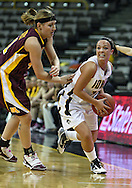 February 18, 2010: Iowa center Trisha Nesbitt (11) tries to get around Minnesota forward Brianna Mastey (41) during the second half of the NCAA women's basketball game at Carver-Hawkeye Arena in Iowa City, Iowa on February 18, 2010. Iowa defeated Minnesota 75-54.
