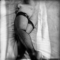 Crossed legs with Fishnet Stockings