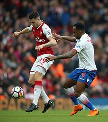 Arsenal's Granit Xhaka (left) and Stoke City's Saido Berahino battle for the ball