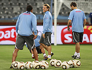 CAPE TOWN, SOUTH AFRICA - 10 JUNE 2010, Diego Forlan shares a joke with Alvaro Pereira and Sebastian Eguren during the Uruguay training session held at the Cape Town Stadium. Uruguay play France in their opening game on Friday 11 June 2010. Photo by: Shaun Roy/Sportzpics