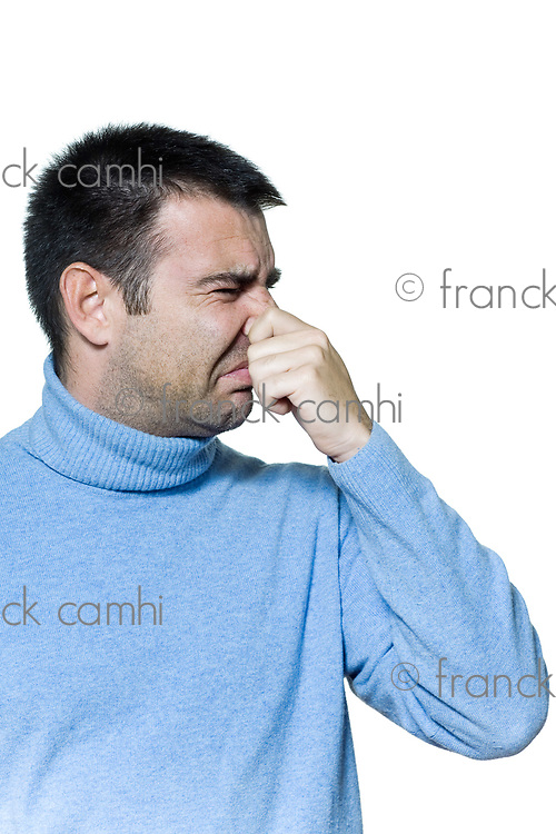 studio portrait on isolated background of a stubble man unpleasant smell stink