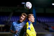 Coventry City defender Kyle McFadzean (5) and AFC Wimbledon forward Joe Pigott (39)  during the EFL Sky Bet League 1 match between Coventry City and AFC Wimbledon at the Trillion Trophy Stadium, Birmingham, England on 17 September 2019.