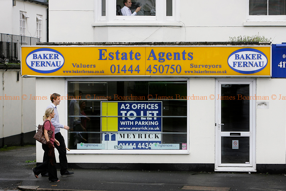JAMES BOARDMAN / 07967642437<br /> People walk past an  Estate Agents office which is up for rent in Haywards Heath West Sussex.
