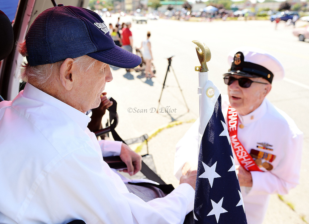 7/4/16 :: REGION :: SMITH :: Parade Grand Marshal J. Deen Brown, right, greets WWII veteran Arthur Olson, 89, of Groton, watching from his viewing position on Poquonnock Rd. for the Groton Independence Day Parade Monday, July 4, 2016. (Sean D. Elliot/The Day)